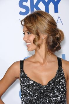 The looped pieces in Jessica Alba's chignon are classic and elegant, while the loose, face-framing curls add a youthful element. This romantic updo is perfect for nearly any formal occasion.