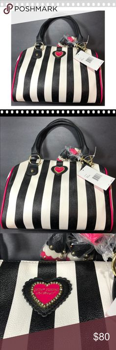 "Betsey Johnson Satchel with key chain Beautiful Betsey Johnson Satchel bag with pink, black, and white! NWT!  The bag is approximately 8"" high x 12"" Long x 6"" wide; straps are about 8 1/2 "" Long   Comes from a smoke free home. Please see my other items - bundle and save! Betsey Johnson Bags Satchels"