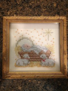 Christmas cross stitch.  Baby Jesus with lambs. Cute little manager scene.