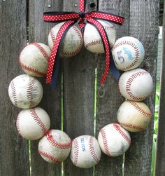 I see a softball wreath in my future! Baseball Love Wreath...Finally, a way to use those signed baseballs teams have given us! Can put a cap in the center and decorate with any color ribbon.