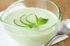 Cucumber Mint Soup (cold)  1 1/2 cups nonfat plain yogurt   1/2 cup sour cream   1/3 cup mint leaves, plus a few extra sprigs for garnish   1/4 cup flat-leaf parsley leaves   3 green onions, trimmed and roughly chopped   2 English cucumbers, peeled, and seeded and roughly chopped   1 clove garlic, roughly chopped   1/8 teaspoon salt   1/4 teaspoon white pepper