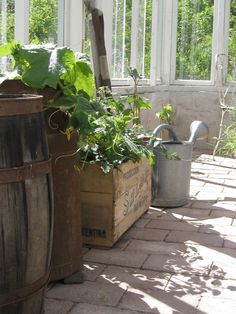 Boxes, crates and rustic watering can <3