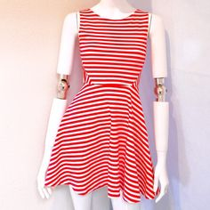 "Divided Short Mini Red / White Dress Divided /H&M Short Mini Red & White Sleeveless Dress. Size Extra Small. 56% Polyester, 39% Viscose, 5% Elastane. Measurements: Armpit to Armpit 13"", Waist 12"", Length 32."" H&M Dresses Mini"