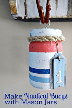 It's time to get your craft on and make Fun Nautical Buoys with Mason Jars   They're a perfect way to add a bit of Whimsy to your Summer Home Decor and create at cool Coastal vibe.  It's EASY with this full TUTORIAL from http://AnExtraordinaryDay.net