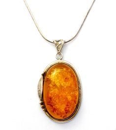 "Fine Jewelry 925 Necklaces - This is a 30 sterling silver chain with a handmade natural honey amber pendant. The pendant measures 2.25"" by 1.25"" and is hallmarked 925. The chain is hallmarked 925 Ital"