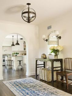 Christine Markatos Design: Stunning foyer design with iron and glass banded globe pendant over blue Persian runner ...