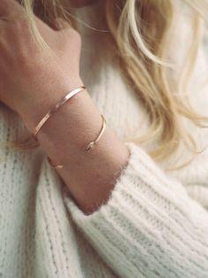 ivory sweater, gold bracelets