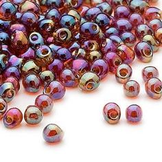 Seed bead, Miyuki, glass, clear rainbow dark amber yellow, (DP257), 4x3.4mm fringe. Sold per pkg of 10 grams.
