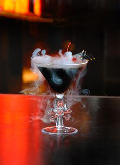 Black Magic Martini   1 1/4 oz. Vanilla Vodka 1 1/2 oz. Patron XO  1 Maraschino Cherry Dry Ice  Add ingredients to shaker with ice and shake. Strain into cocktail glass and garnish with a cherry. To creat boiling effect, add dry ice according to package directions.