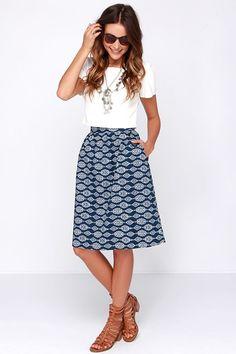 Navy Print Midi Skirt, white top, camel sandals.