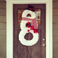 """Snowman Christmas Wreath DIY with Christmas lights, ornament """"buttons"""", top hat and scarf."""