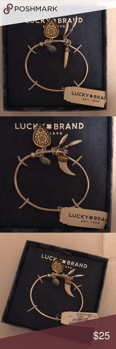 NWT Lucky Brand Bangle Brand new with tags silver bangle from Lucky Brand. Has pretty turquoise and gold accents. Make me an offer. NWT Lucky Brand Jewelry Bracelets