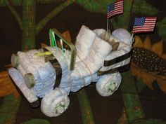 Diaper Cake Ideas That You Can Try Out : Jeep Diaper Cake Instructions. diaper cake decoration,diaper cake for baby shower Baby Shower Cake Pops, Baby Shower Gifts, Baby Gifts, Diaper Cake Centerpieces, Baby Shower Centerpieces, Airplane Diaper Cakes, Baby Hospital Gifts, Jeep Diaper Cake, Butterfly Diaper Cake