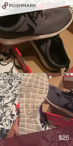 Nike rosherun (GS) Grey and black roshes. Worn a couple times. I will clean if purchased. Comes with the box if wanted :) Nike Shoes Sneakers