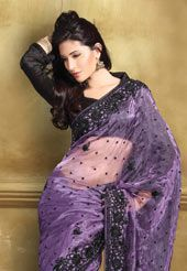 Violet Tissue Saree with Blouse. This violet tissue saree is designed with resham, sequins and patch work.