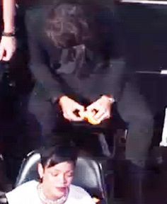 Harry eating an orange in the middle of the VMAs. Cause you know, popcorn is too mainstream.