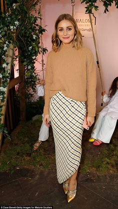 Giddy: Later in the day, the reality star looked cozy in her yellow, white and black skirt...
