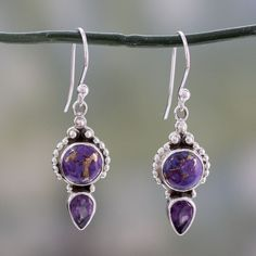 Luscious purple seduces the senses in these dangle earrings presented by Shanker in India. The sterling silver earrings feature 1.5 carats of faceted amethyst, topped by cabochons of intriguing copper-streaked purple composite turquoise.