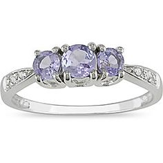 @Overstock - Attractive ring showcases vibrant blue hue of tanzanites   Jewelry is crafted of 14-karat white gold   Ring shimmers with twinkling side diamonds http://www.overstock.com/Jewelry-Watches/14k-White-Gold-Tanzanite-and-Diamond-Ring/4023917/product.html?CID=214117 $148.99