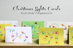 Homemade Christmas cards featuring toddler and preschooler fingerprint Christmas lights. They are fun, easy and quite effective too.