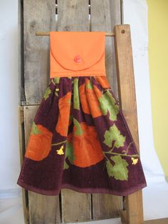 Fall Pumpkin Kitchen Towel Hanging Kitchen Towel with Pumpkins, via Etsy.