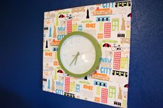 Alayna's Nursery Tour - Deep colors, bright patterns and vintage travel theme.  Clock on canvas.