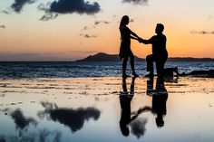 She said yes! Proposal photography at sunset in Oahu Hawaii by OceanBodhiPhotography.com