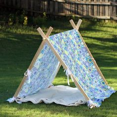 An easy weekend project that you can make for about $30, a tent that can be used both indoors and out, and folds flat for storage.