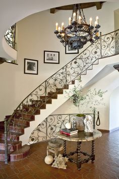 This 1920's Spanish Revival home features original ornamental ironwork, intricate corbels, elaborately decorated ceilings, and hand painted tiles.