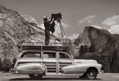 Ansel Adams photographs Yosemite from the roof of his car. 1942