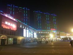More illuminated buildings and tv screens
