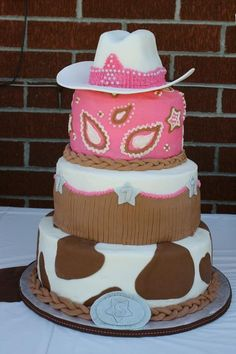 cowgirl birthday cake - 3-tier cake with buttercream icing and fondant accents.