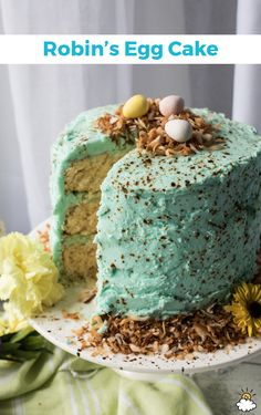Triple-layered and splattered with creative speckles, our Robin's Egg Cake Recipe is the perfect addition to your spring time baking file! Decorated with crispy toasted coconut and topped with Robin's Egg candies, this cake is perfect for Easter, a garden party and more.