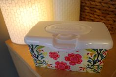My baby wipes pop-up container box has become a fixture on Elise's shelf so I thought why not make it extra pretty? So I decided customize it by covering it with fabric. Here's what the Huggies baby wipes pop-up container tub looked like before: Not too bad but I wanted something more custom. So I