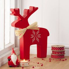 large nordic wooden christmas reindeer by the contemporary home | notonthehighstreet.com