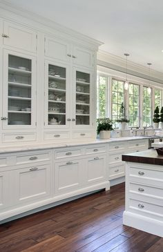 White traditional kitchens never go out of style. www.prasadakitchens.com