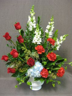 Funeral flowers in red, white and blue. #funeralflowers