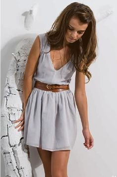 Leather belt and grey dress