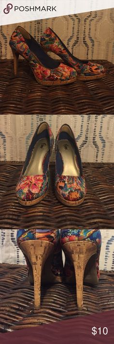 Floral shoes Beautiful pair of flower shoes! Has every color you can think of. Absolutely love these shoes but sadly they are too big! Have obvious signs of wear which is pictured. Also has small pads on the inside back of the shoe. 5 inch heel with a 1 inch platform Fioni Shoes Heels