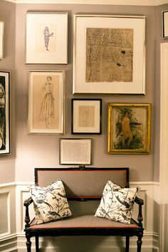 Kate Spade foyer bench gallery wall