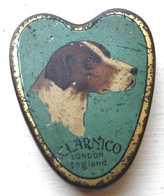 Miniature tin with dogs head for CLARNICO, London, England. c. early 1900s