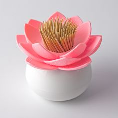 LOTUS TOOTHPICK HOLDER (WHITE/PINK) - This Lotus Toothpick Holder is a chic way to keep toothpicks close at hand, whether at your cubicle or in your kitchen. Be sure to check out our other available colors as well! Comes in beautifully designed and fun 100% recycled paper packaging printed with soy ink. www.cubiclelife.com