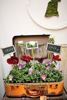 Dishfunctional Designs: Creative Uses for Vintage Suitcases. Can use with artificial flowers