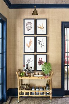 The Glam Pad: Kemble Interiors Revives a Palm Beach Retreat / sea grass wallpaper with navy trim, botanical prints, and bamboo bar cart Interior Trim, Interior Design, Interior Shop, Trim Paint Color, Paint Colors, Painting Trim, House Painting, Bars For Home, Palm Beach