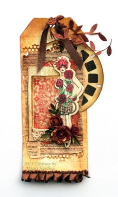 Tag. Like the use of the old view master reel, playing card and botanicals. **Flying Unicorn May kOM** - Scrapbook.com
