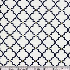 Get into a nautical mood with this fun, glam collection! Crisp navy blue and white are paired with touches of gold for a cool, summery feel. Reminiscent of architectural ogee curves, this print features tiny gold ovals with navy. This quilting weight fabric is 100% cotton and is 44/45