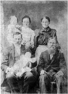 Houston Blevins (seated, left) holds Maude. Rosa Marcum Blevins ,Scott County TN