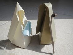 This is a unique origami nativity set, perfect for collectors and lovers. It only uses origami technique and is glued in some folders so that it stays