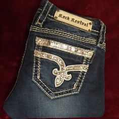 Rare Sherry straight RARE SHERRY STRAIGHT Good condition there is 2 sequins missing unless they are made like that. Length is regular around 31. One stitch came loose it shows in pic 4. I'm a 27 and these fit me they do stretch thou. Will wash before sending. Rock Revival Jeans Straight Leg