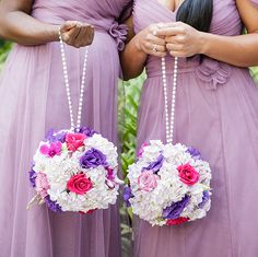 Lavender bridesmaid dresses with hanging flower poms. #purplewedding